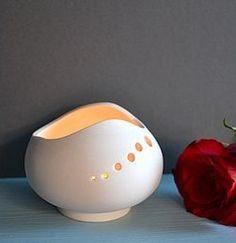 Handmade matt white contemporary porcelain tea light holder.