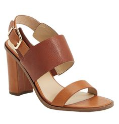 A mid-height heel in a neutral color like this one from Via Spiga is great shoe for any day of the week.