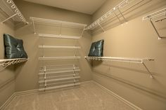 Large walk-in master closet with wire shelving