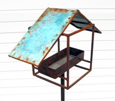 Sculptural Bird Feeder 270 birdhouse turquoise roof modern robins egg blue. $175.00, via Etsy.