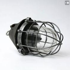 cage light-use with other styles of cage lights over kitchen island.  Could have 7 total: three edison bulbs for atmosphere and 4 halogens for task lighting.