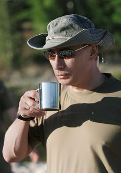 Sexy pic of Putin- I never wanted to be a cup of coffee before I saw this.