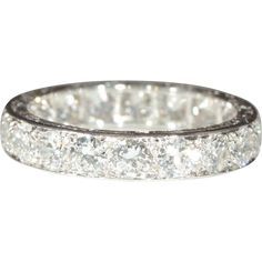 This jaw-dropping eternity ring was made in France during the 1940s.  The hand engraved platinum band holds nineteen diamonds set in a endless circle   WHOA!!!!