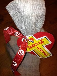 Socks of Love! Fill one sock with necessities (toothbrush, soap...)- put the other sock in too and donate socks of love to homeless shelters and such! This would be a good idea for Cub Scouts, school kids, or Sunday School classes to give to the veterans, homeless shelters, or nursing homes