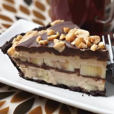 Frozen Chocolate Peanut Butter Banana Pie Recipe.  I made this - the flavors are great, but I will need to tweak measurements to make the PB and chocolate layers easier to spread.