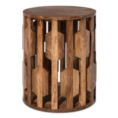 Place extra tabletop storage in your living room without weighing down the look with the Threshold Carved Wooden Accent Table. This drum side table has a carved pattern that creates visual space that presents a feeling of lightness and flow.