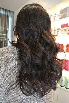 Chocolate balayage highlights on black curls