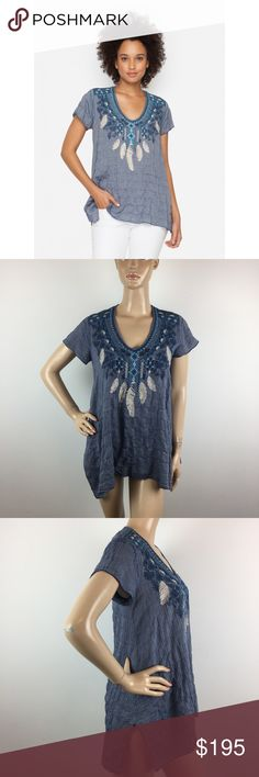"""Johnny Was Mya Drape Blue Chambray Embroidery Top The 3J Workshop MYA TOP is the perfect way to inject a little boho brilliance into your style.With an A-line silhouette & handkerchief hemline,the shilhouette on this flowy slip-on top is perfect.The eye-catching embroidery design that features feathers,flowers and graphic details only adds to the allure. Please note that the measurements are approximate MEASUREMENTS ARE TAKEN WITH GARMENT LYING FLAT: SLEEVE:5"""" BUST:18"""" WAIST:24"""" LENGHT:27""""…"""