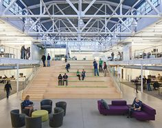 Gold Rush - A row of bleachers is Atlassian's central meeting area and auditorium #office #interior