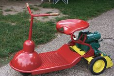 Michigan couple's antique mower collection paints a rainbow.