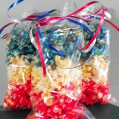 Patriotic Popcorn    This fun red, white, and blue popcorn is a fun treat to eat while enjoying the 4th of July fireworks.  Make each member of your family their own fun bag to enjoy.
