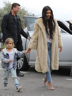 Kourtney and Kim Kardashian visit an ice-cream store with Penelope #dailymail