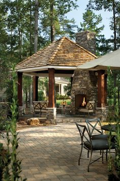 This is what I will be doing with my gazebo with cedar columns and stone. The roof will be black asphalt shingles