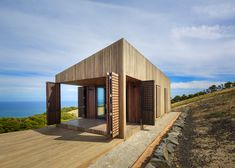 """Australian architects Jackson Clements Burrows added perforated shutters to the exterior of this holiday cabin """"like a Gore-Tex jacket"""", providing light and ventilation when closed."""