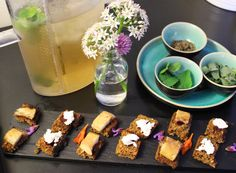 Burren Belini of smoked mackerel and goats cheese. with Iced green tea and garden herbs.