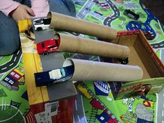 DIY cardboard garage and car tracks