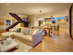 Modern, but not at all cold.   Favorite Features: open floor plan, lighting, bamboo floors, stairs