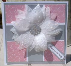 Happy Anniversary  stamped several five petal flowers onto vellum using Stampin' Up! White Craft Ink, then cut them out. The top layer has a touch of Diamond Stickles added for a bit of sparkle.
