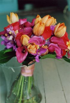 If you are a lover of color consider using deep orange roses with pink roses, purple and green hydrangea and pink mini calla lilies, yellow tulips, white calla lilies and cymbidium orchids
