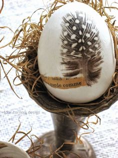 Feather embellished Easter eggs by  Four Corners Design featured on I Love That Junk