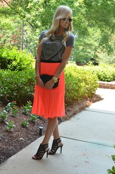 Friday I'm in Love. grey top, neon orange pleated skirt.
