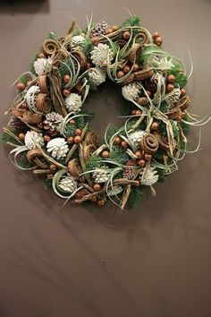 Wintery mixed pine cone, berry and assorted greenery wreath for Christmas.