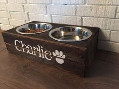 Rustic Custom Made Elevated Wooden Dog Bowl Feeder-With Two Bowls by BlueCharlieDesigns on Etsy https://www.etsy.com/listing/248143673/rustic-custom-made-elevated-wooden-dog - Tap the pin for the most adorable pawtastic fur baby apparel! You'll love the dog clothes and cat clothes! <3