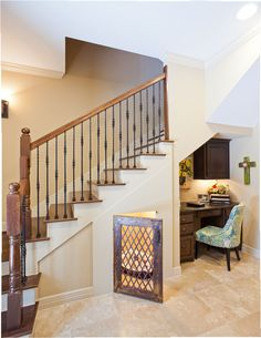 Erika Barczak, By Design Interiors. Creative use of space by incorporating a dog kennel under the staircase!