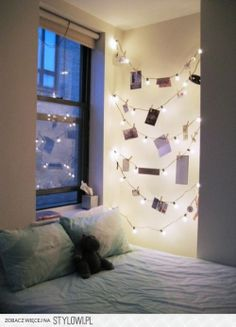I love the simple string lights on the wall.  This would be great for dim lighting in the evenings.  It spuces up the odd small panal of walls in a bedroom and can double to hang pics/notes on it.