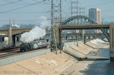 Santa Fe 3751 steams past the 6th Street Bridge along the Los Angeles River; it was pulling a passenger special to San Diego.