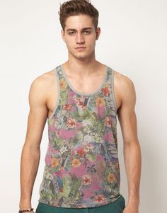 This vest by ASOS has been constructed in cotton blend jersey. It comes in a regular fit. The details include: a floral print design and contrasting plain reverse, a scoop neck andsleeveless styling.
