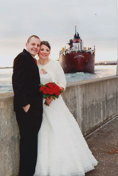 What a gorgeous picture of our bride and her husband at the pier.  Love her wrap!