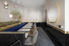 Restaurant in Paris, parisian atmosphere with sofa, round mirror, interior design by Rodolphe Parente and Benjamin Liatoud