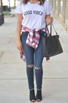 perfect weekend fall outfit - good vibes tee, red plaid top at waist, distressed skinny jeans, peep toe booties | http://www.fizzandfrosting.com