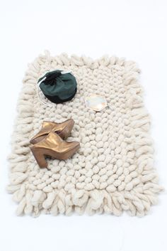 Hand-loomed and woven bouclé pile rugs, 100% virgin earth friendly wool in a chunky plush style. Amazingly soft and luxurious. Artisans weave, clean, spin and dye the rugs, using their own wool, and t