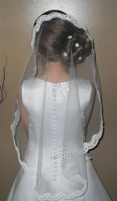 Becca in her lace mantilla veil with crystal cross