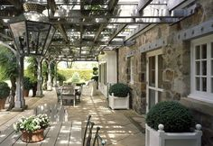 French Architecture - A Norman Carriage House and Trellis