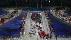Athletes enter the arena during the 2014 Sochi Winter Olympics Closing Ceremony.