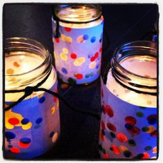 Such a cute idea - drip hot wax from different colored candles onto paper and tape around Mason Jars to create colorful lanterns!
