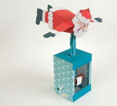 Just in time for Christmas! Turn the handle on the Flying Santa and his arms [. Christmas Paper, 1st Christmas, Christmas Stuff, Paper Art, Paper Crafts, Paper Models, Wood Toys, Folded Up, Paper Toys