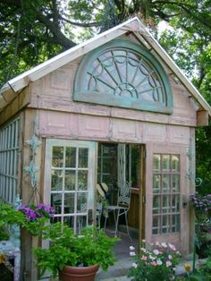repurposing old doors and windows | greenhouse made from old windows, love the tin siding (old tin ceiling ...