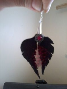 black leather with scarlet red leaf and stone earrings