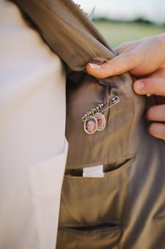 groom with grandparents' photo pinned to inside of suit | Shea Christine Photography | Glamour & Grace