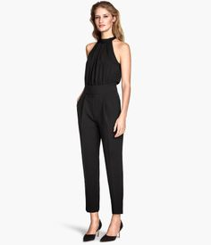H&M Sleeveless Jumpsuit $59.95 Sleeveless jumpsuit in woven fabric. Bodice with tie at neckline, pleats at front, and seam at waist. Pants with side pockets, pleats, tapered legs, and concealed side zip. Unlined. DETAILS 90% polyester, 10% spandex.