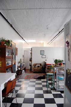 White walls. B+W check floor.
