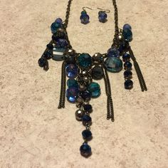 "Blue Green Crystal Bead Necklace with earrings Just like new glass crystal beads with beautiful shades of blue and green graduated beads on a gunmetal chain 16-18""inches adjustable lobster closure and matching crystal earrings with French Hooks approximately 1.25 inches long Jewelry Necklaces"