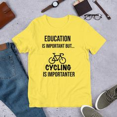 Cycling T Shirt, Education Is Important But Cycling Is Importanter T-Shirt , #Cycling, Funny Cycling Unisex T-Shirt, Gifts For Cyclist  This t-shirt is everything you've dreamed of and more. It feels soft and lightweight, with the right amount of stretch. It's comfortable and flattering for both men and women.   • 100% combed and ring-spun cotton (Heather colors contain polyester) • Ash color is 99% combed and ring-spun cotton, 1% polyester • Heather colors are 52% combed and ring-spun… Funny Qotes, Crazy Quotes, Clothing Websites, Ash Color, Funny Design, Cool Bikes, Funny Shirts, Cycling, Feels