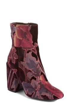 A wrapped block heel balances the streamlined silhouette of an elegant  velvet bootie detailed with floral 43f6d3c37