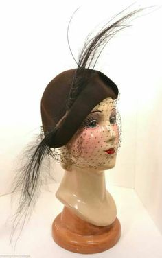 Feather Hat in brown with veil.  ♡