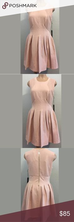 """BCBG MAX AZRIA Medium blush pink tulip dress New with tags BCBG MAX AZRIA Medium tulip dress, fit and flare, sleeveless, back zipper, beautiful blush pink color. 60% cotton 35% polyamide 5% Elastane. Lined. BUST 17"""" armpit to armpit. WAIST 14"""" side to side. LENGTH 34"""" shoulder to hem. Measurements are approximate. MSRP $368 BCBGMaxAzria Dresses"""